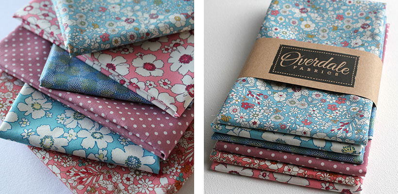 blue and pink fat quarter fabrics shown in their packaging