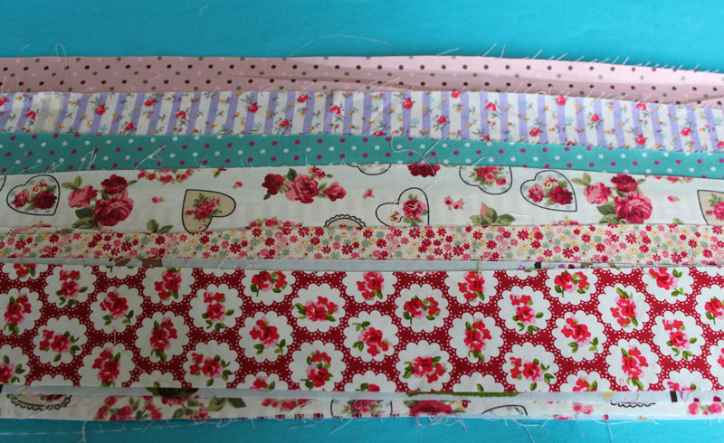 Ironing scraps to make a jelly roll.
