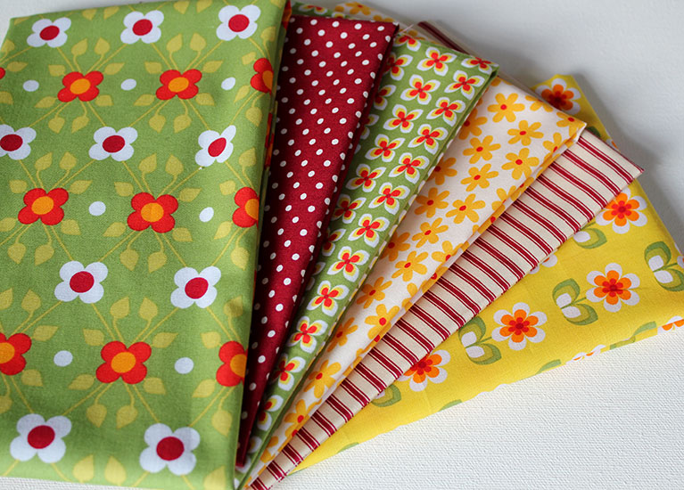 Retro floral fabrics in green, red, yellow and orange.