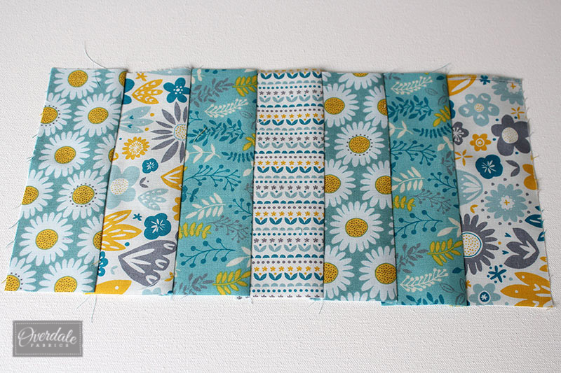 Side panel of the placemat made from jelly roll fabric.