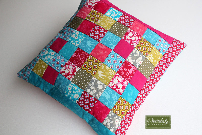 Quilted patchwork cushion cover.